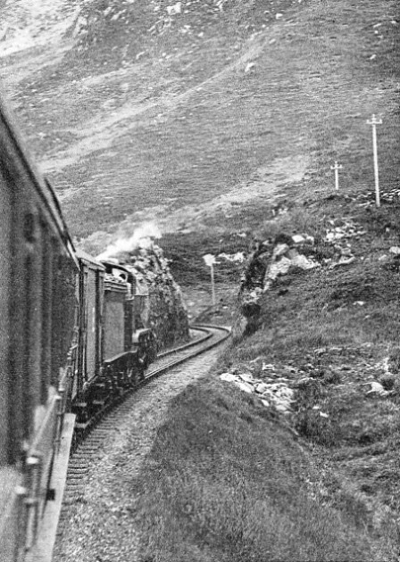A London and North Eastern Railway train passing along a stretch of line between the stations of Arisaig and Mallaig