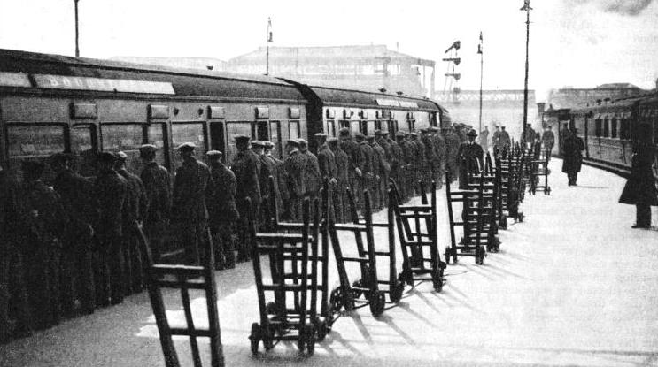 Porters awaiting the arrival of a train at Waterloo