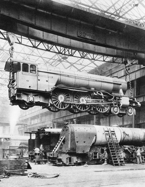 "A 90-tons three-cylinder ""Pacific"" engine, built by the North British Locomotive Company for the LNER, lifted by a giant travelling crane"