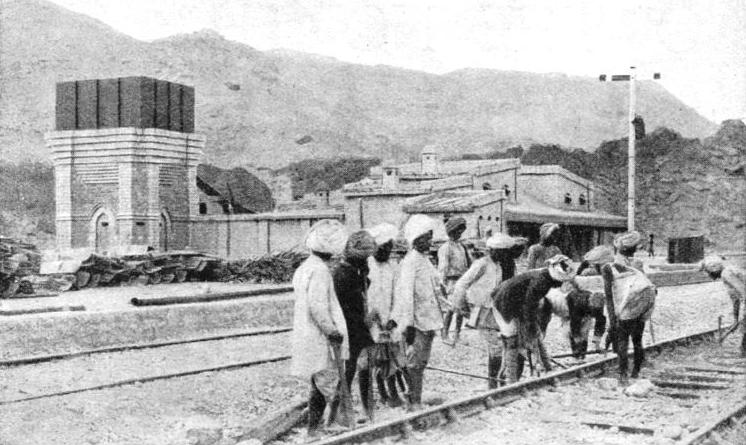 INDIAN LABOURERS AT WORK, renewing the ballast of the permanent way in a typical siding