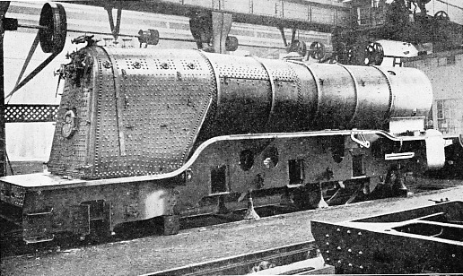 "BUILDING A "" PACIFIC "" ENGINE AT DONCASTER THE BOILER IN POSITION ON THE FRAMES"