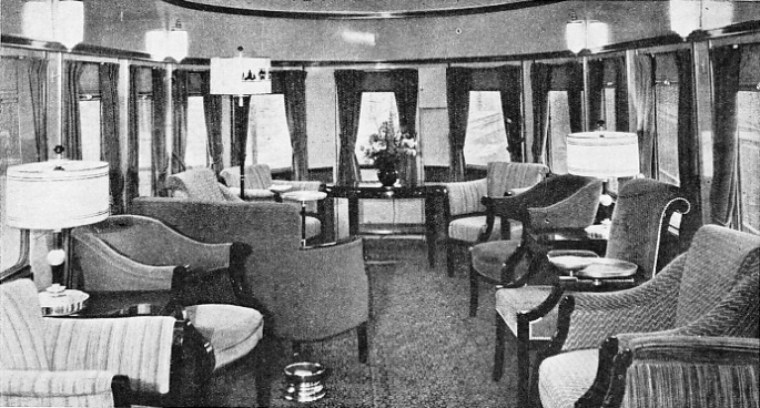 "this handsomely furnished observation lounge on the rear of the Baltimore and Ohio Railroad's new streamlined express, the ""Abraham Lincoln"""