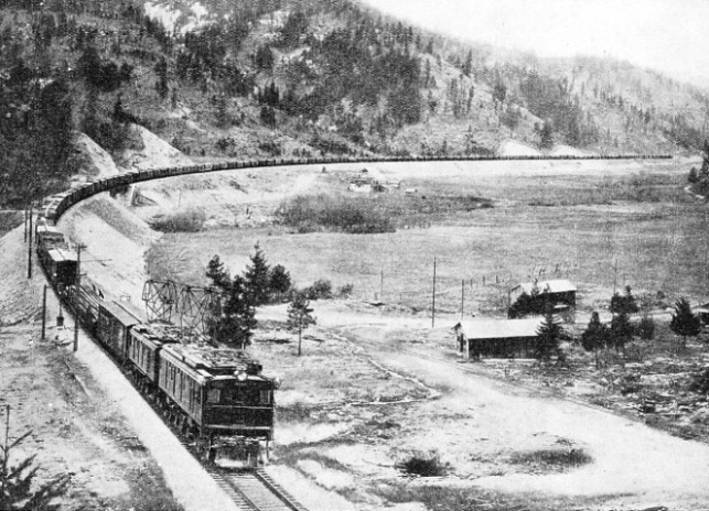 LARGE ELECTRIC LOCOMOTIVES, such as those shown above, now haul the huge freight trains through the mountains