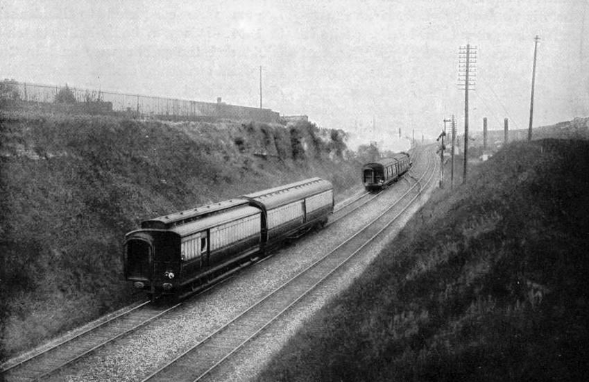 SLIPPING TWO COACHES OFF THE UP AMERICAN MAIL WHILE TRAVELLING AT 60 MILES PER HOUR