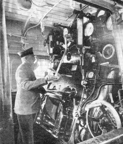 AT THE CONTROLS of a German locomotive