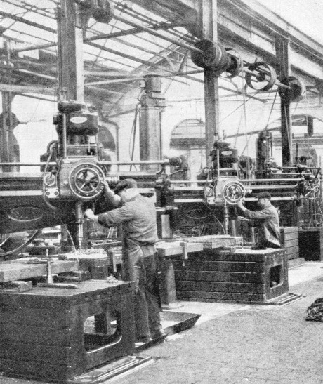 Radial drills at work on four locomotive frames