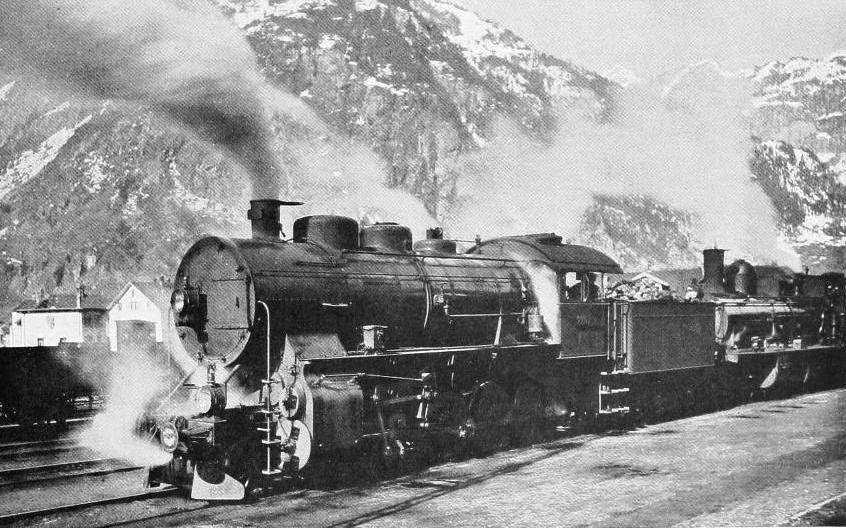 TO HAUL THE HEAVY EXPRESSES OVER THE ST. GOTTHARD PASS AND THROUGH THE FAMOUS TUNNEL, DOUBLE-HEADING IS PRACTISED