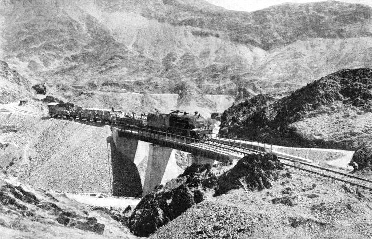 A local train is crossing a bridge not far from Shahgai, on the Khyber Railway