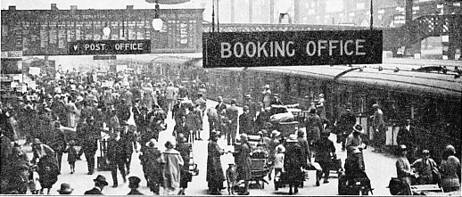 A HOLIDAY SCENE AT LIVERPOOL STREET STATION
