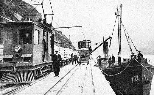 TRANSFERRING ALUMINIUM from an electric train to ship at one of the quays at Kinlochleven