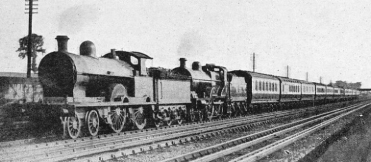 "A London and North Western Engine ""piloting"" a Midland Engine on a Manchester Express"