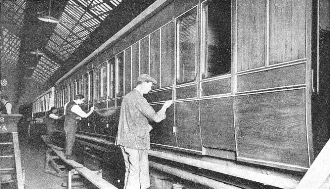 "men at work ""lining"" a carriage at the LNER shops at York"