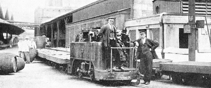 0-4-0 TANK ENGINE at the head of a train of flat wagons at St. James's Gate Brewery