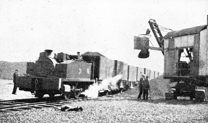 A SMALL TANK LOCOMOTIVE at work on the industrial railway at Beckton Essex, belonging to the Gas Light and Coke Company
