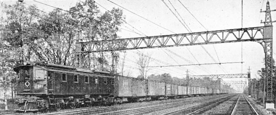 MAIN LINE ELECTRIC FREIGHT LOCOMOTIVE AND TRAIN ON THE NEW YORK, NEW HAVEN AND HARTFORD RAILROAD