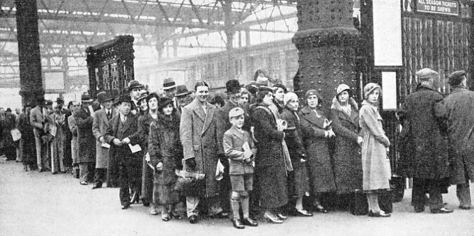a typical crowd queuing up for a holiday train at Waterloo Station