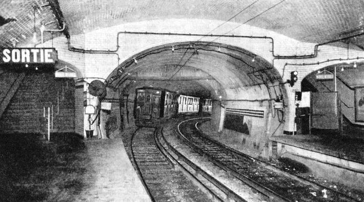 ON THE PARIS UNDERGROUND. A train entering the station of Place d'Italie