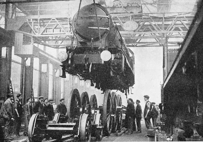 Raising an express passenger engine off its wheels for the purpose of an overhaul at the Southern Railway's works at Eastleigh