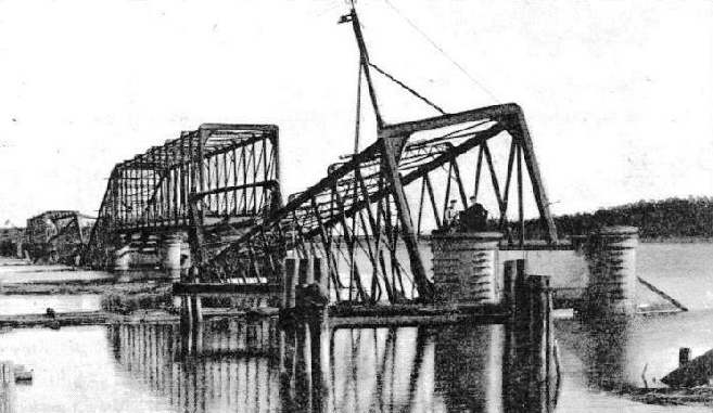 Wrecked railway bridge across the Lielupe near Riga