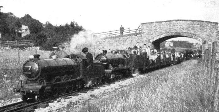 DOUBLE HEADING. Two fine locomotives with a train-load of holiday-makers on the Eskdale Railway