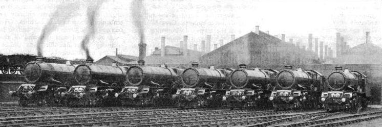"A magnificent line of ""Kings"" outside their engine-sheds ready for service"