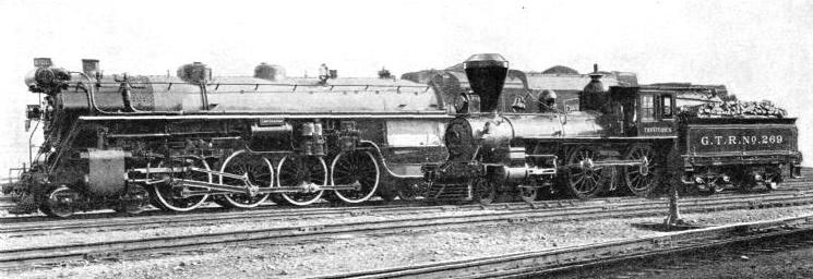 "An early Canadian locomotive, ""Trevithick"", standing by the Canadian National Railways' 4-8-4 express engine ""Confederation"""