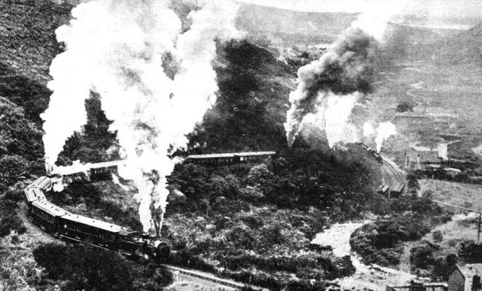 The royal train, carrying H.R.H. the Duke of Gloucester, ascending the famous incline up the Rimutaka Mountains