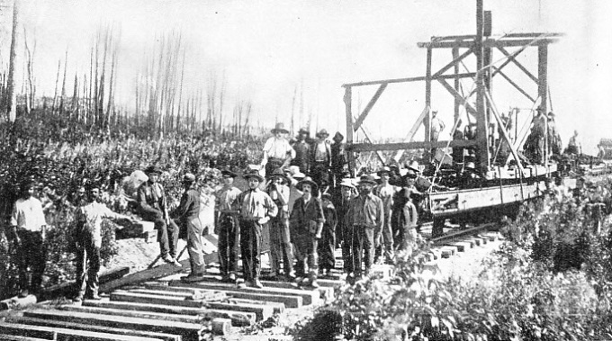 Foot by foot the railway engineers thrust the metals across Canada