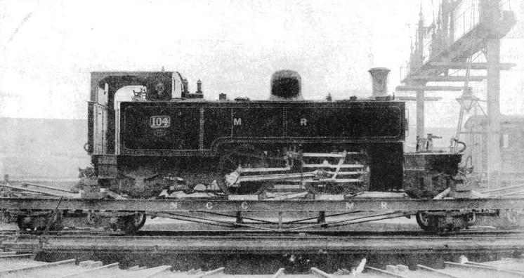 A narrow-gauge 2-4-2 compound engine on a broad-gauge transhipment truck at Belfast