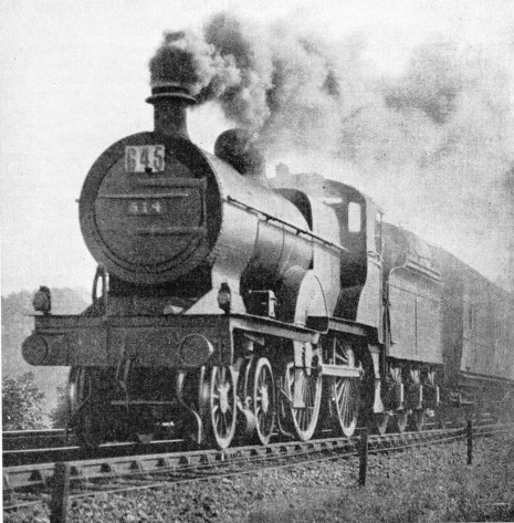 An oil-burning 4-4-0 locomotive on the LMS near Ambergate