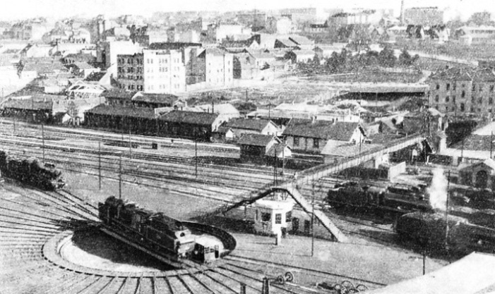 IN BELGRADE. A view of the locomotive depot and of a new turn-table outside the engine-sheds