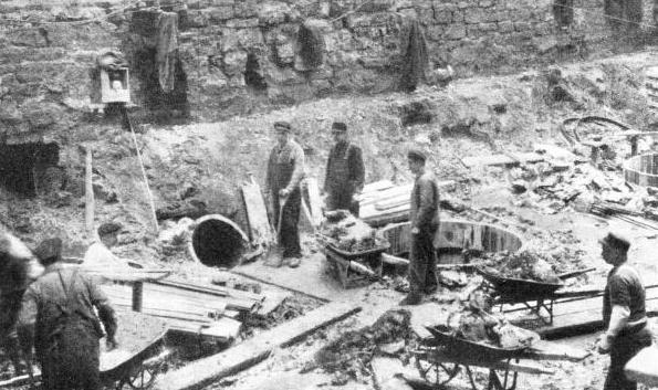 AN UNUSUAL METHOD of disposing of soil excavated during the laying of foundations for buildings in Chicago is provided by the freight tunnels