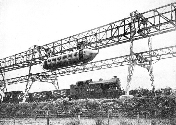 The cars are suspended from bogies running on an overhead rail